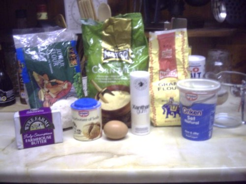 Baking ingredients, including flours, butter, xanthan gum, and yogurt