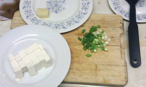 Cubed tofu, crushed garlic, and sliced green onion waiting to go in the pan.